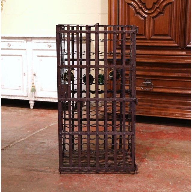 Decorate a wine cellar with this exquisite antique wine storage cage. Forged in the Burgundy region of France and...
