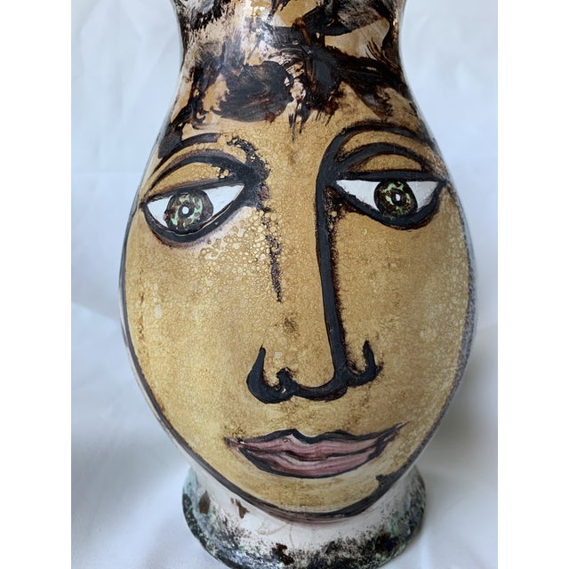 Offered is this original hand painted art pottery pitcher vase, signed and dated by the artist. The freeform design of...