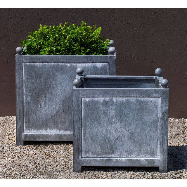 A square planter made of Zinc coated Steel.