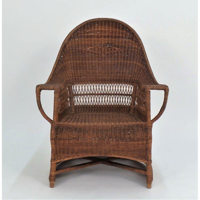 An English, Arts and Crafts period cane armchair by Dryad and Co. circa 1910. With Dryad brass label. Designed by Harry...