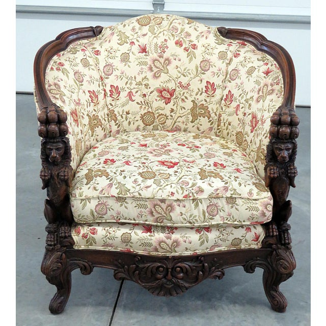 Carved Victorian bergere with tapestry upholstery.