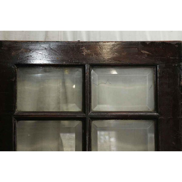 A beveled flass 21 panel window. In good condition with no broken glass.