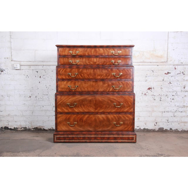 An exceptional chest on chest highboy dresser by Maitland Smith. The dresser features stunning flame mahogany wood grain...