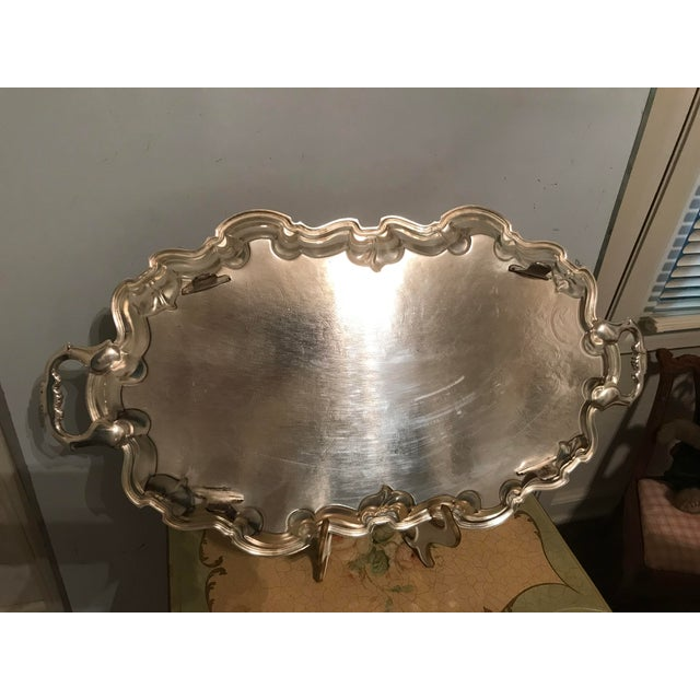 Vintage ornate butler tray with curved edges and central design , very classy and classic , it will add charm to any table...
