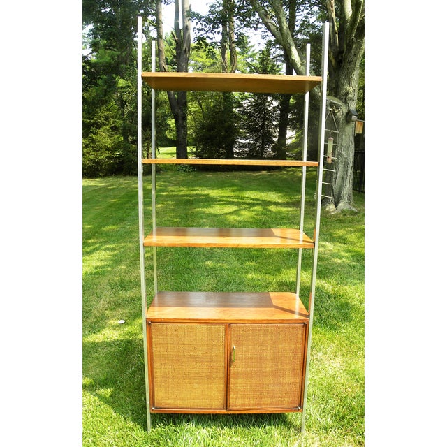 Mid-century walnut wall unit with chrome vertical supports. Woven front and dark rich wood. Works great as a book shelf,...