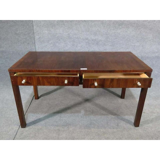 Midcentury desk in rosewood grain with two drawers. (Please confirm item location - NY or NJ - with dealer).
