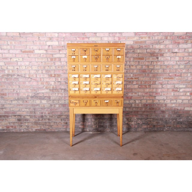 "A rare and exceptional mid-century modern 35-drawer library card catalog By Remington Rand USA, Circa 1950s Measures: 33""W..."