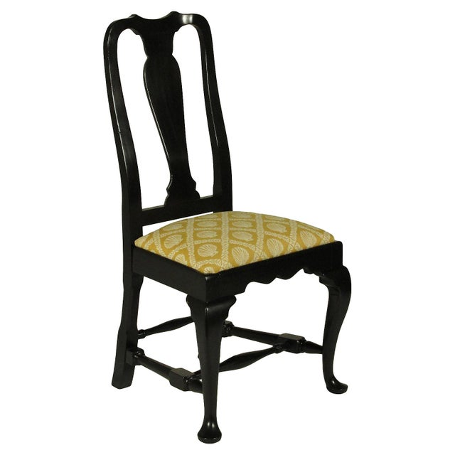 A set of eight (2 arms) Queen Anne-Style dining chairs with hand rubbed black lacquer finish and new Cowtan and Tout...