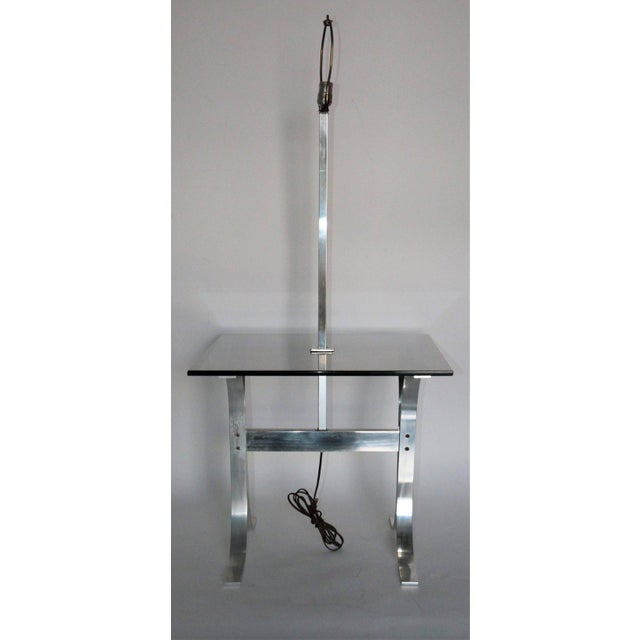 Mid-Century Modern side table with a built in lamp and tinted glass. Made of chrome. IN THE STYLE OF Mid-Century Modern...