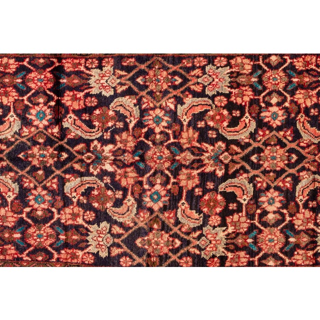 A hand-knotted vintage Hamadan rug with a floral design. This piece has great detailing and colors. It would be the...