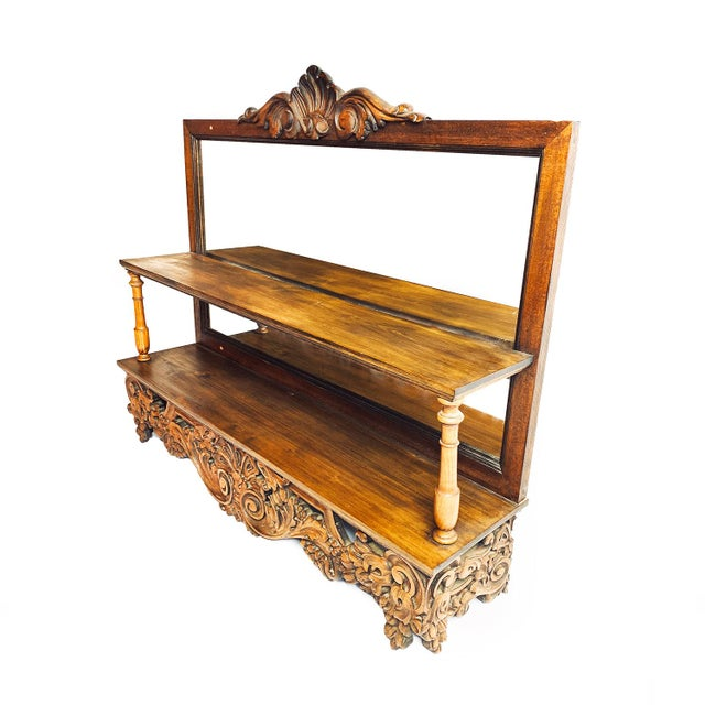 Antique victorian large hand crafted wooden shelf with mirrored back. This is a large and substantial piece that can sit...