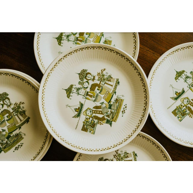 Set of 8 dinner plates with a playful maritime theme. Made in Norway.