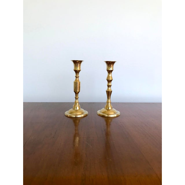 "Two vintage brass candle holders. They are the same size but have different body designs. Marked ""Made in India"" on the..."