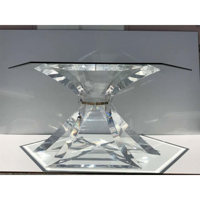 Lion in frost lucite dining table with hexagon glass top and solid brass center. Truly stunning piece but super hard to...