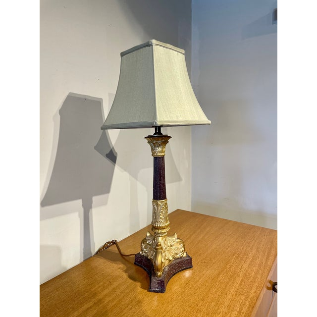 """French Empire style column lamp with gold-trimmed capital and base. Lampshade dimensions 8.5"""" tall 5"""" top width and 9""""..."""