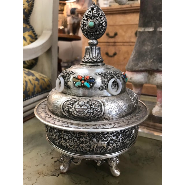 A silvered over copper Mongolian censor. Set with turquoise and lapis on three figurative feet. Late 19th century to early...