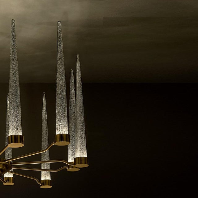 English brass with silver flecked clear glass. There is a dimmable integral light source in the base of the glass icicles...