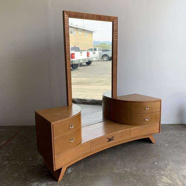 Fully restored vanity and mirror designed by Paul Frank and manufactured by Brown and Saltman. Item features full length...