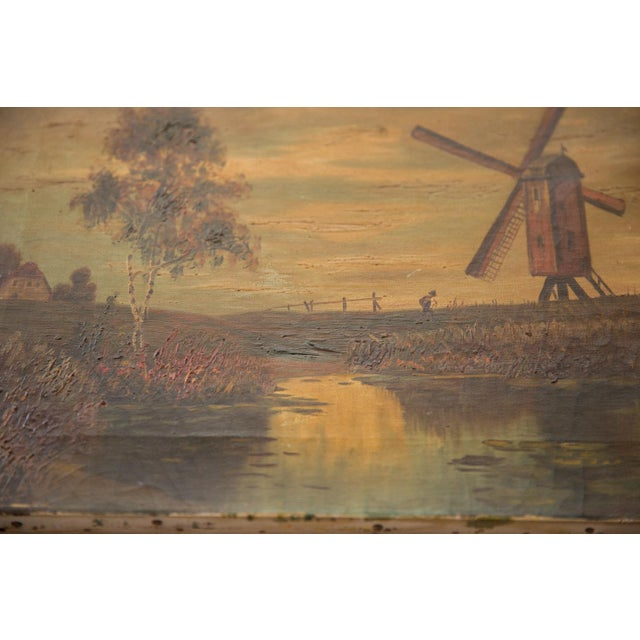 :: Antique oil on canvas countryside landscape painting featuring a little boy walking towards or past a large windmill....