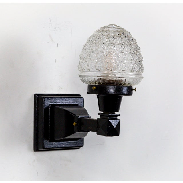 These 1920's American wall lights have a great contrast between the organic look of the pressed glass acorn, and that of...