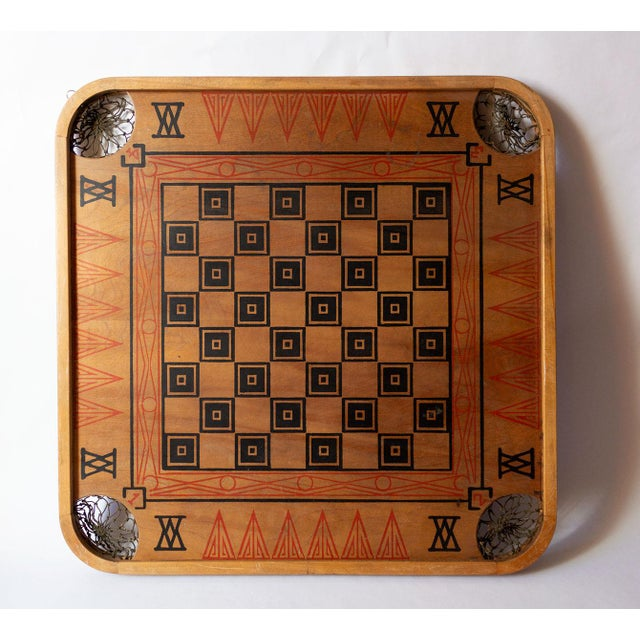 A beautiful example of a classic Carrom board, made by The Carrom Company in Ludington, MI. Circa 1935. Bold black and red...