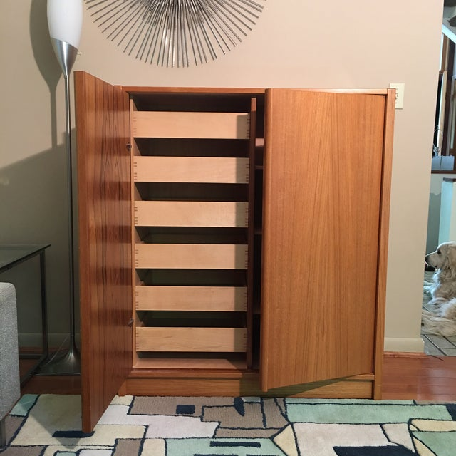 Beautiful gentleman's chest by Danish manufacturer Jesper. Made with warm teak wood grain, sturdy doors, multiple storage...
