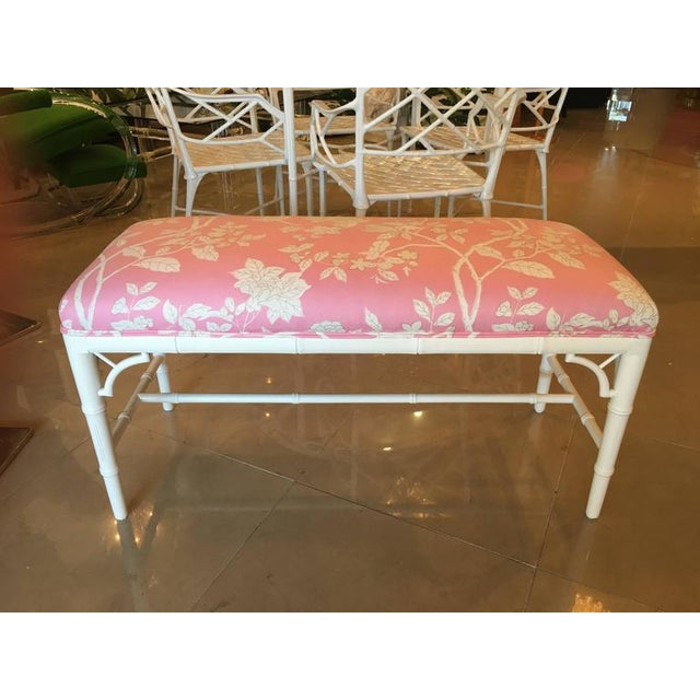 Newly lacquered in a white gloss finish with a newly upholstered pink and white chinoiserie designer fabric faux bamboo,...