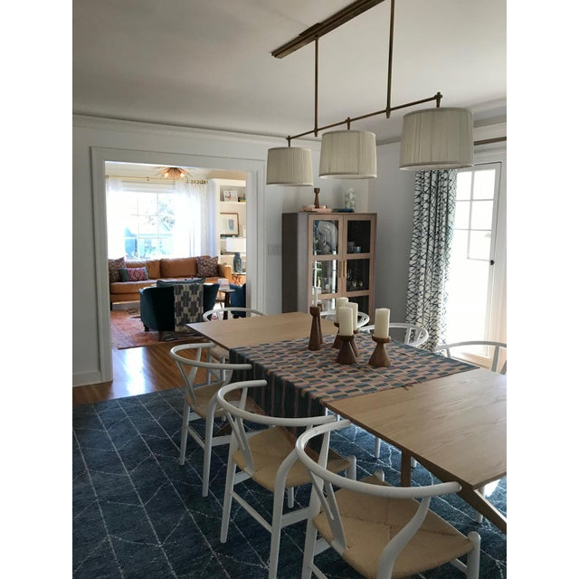 For sale is (1) briefly used Bryant 3-light chandelier in Antique Brass Finish from Circa Lighting by Thomas O'Brien....