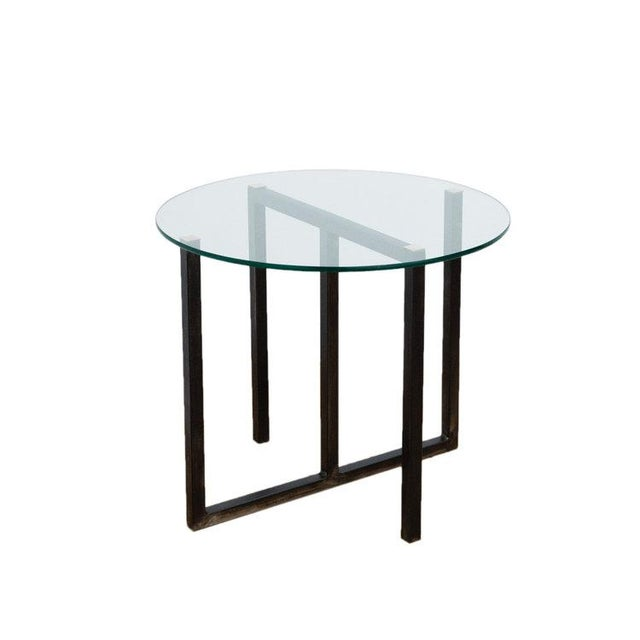 The design of the Lloyd Side Table plays with the ideas of symmetry and difference. The table is a conscious juxtaposition...