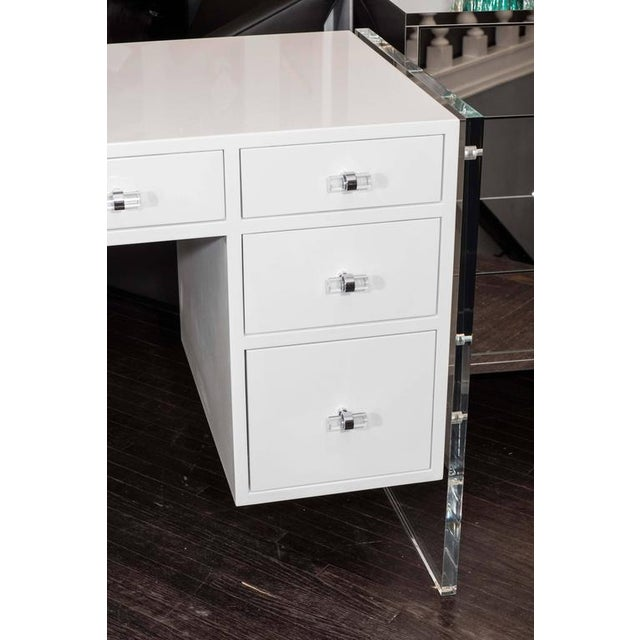 White high gloss lacquer desk with Lucite side panels.