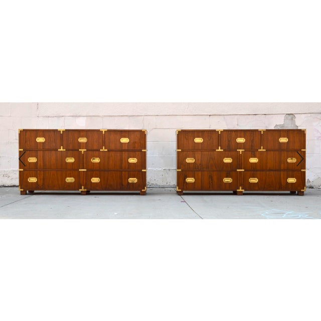Stylish pair of Campaign style baker chests of drawers each have 7 drawers and are made from book-matched walnut with...