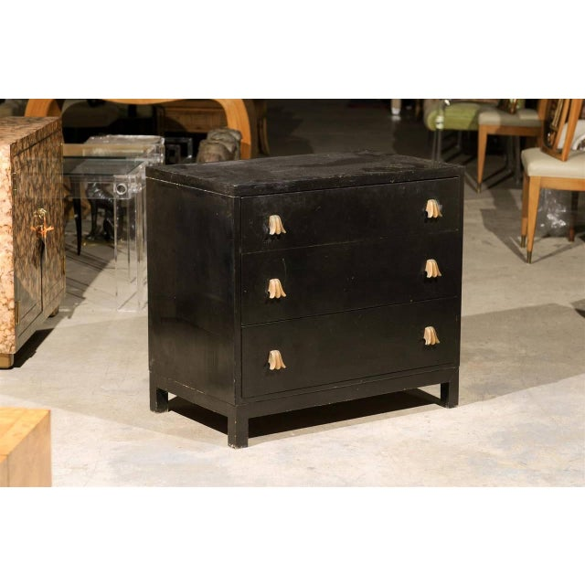 A beautiful three ( 3 ) drawer chest by T H Robsjohn-Gibbings for Widdicomb, circa 1950. This unusual piece is highlighted...