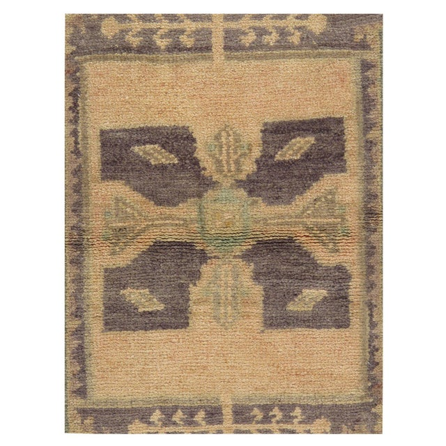 A vintage Turkish Yastik Wool Rug. Yastik's are small size rugs that are adaptions of traditional Turkish designs. Hand-...