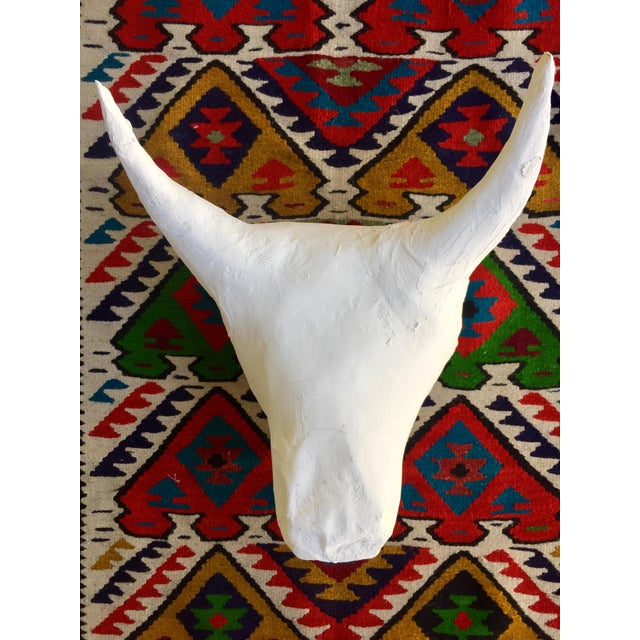 Our one of a kind, handmade, raw plaster and paper mache white bulls head wall candy is a dreamy minimalist piece of...