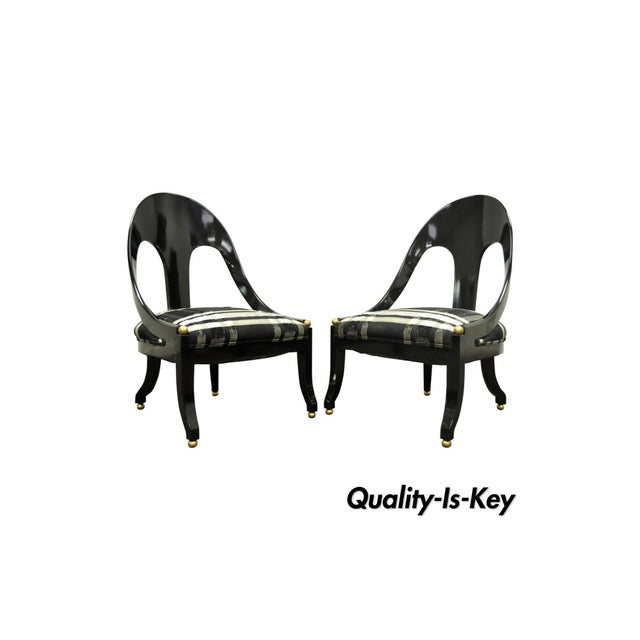 Pair of Michael Taylor for Baker Black Lacquer & Gold Spoon Back Slipper Lounge Chairs. Item features the chairs feature a...