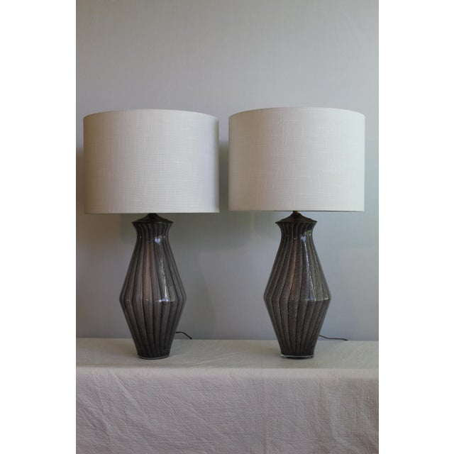Unusual pair of striped Murano Glass lamps.Hand blown stretch in glass. Giving pattern almost uneven and interesting look....