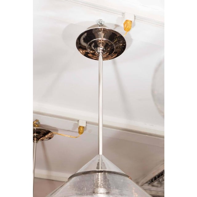 Pendants with Prism Globes and polished nickel finish rods and canopy.