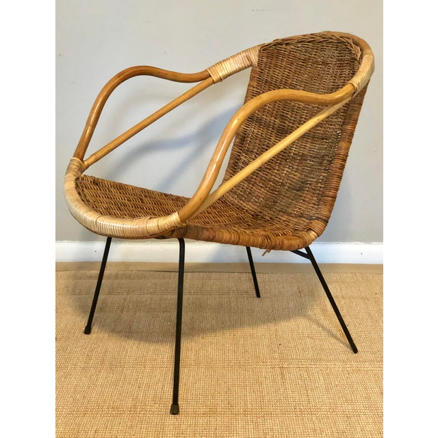 A cool little bamboo and rattan accent chair with iron legs. Circa mid 20th Century.