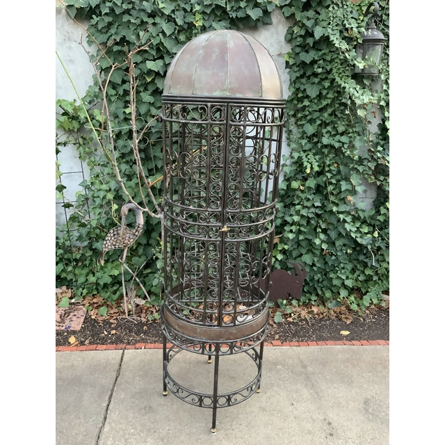 Maitland-Smith copper domed and iron wine rack. Both doors open outward with the fabulous brass hand hardware Maitland is...