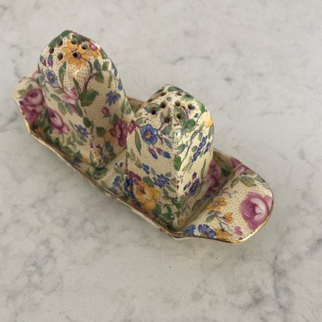 Vintage Clevedon Chintz Flora Salt & Pepper Set on a matching Tray. This set is the older style. Marked Royal Winton...