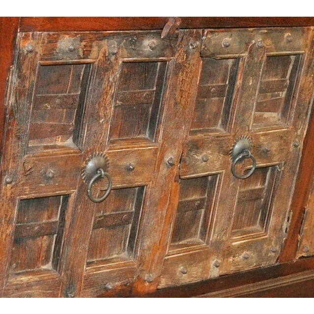 Antique Teak wood door from late 1800's has been thoughtfully repurposed to craft this sideboard. This robust Spanish...