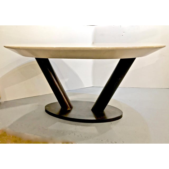 This is a very unusual Karl Springer lacquered goat skin table featuring a modernist steel base supporting a cream...
