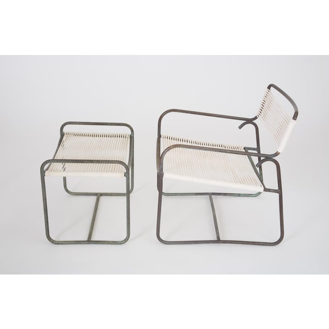 A wide patio lounge chair with matching ottoman by Walter Lamb for Brown Jordan. The set has a simple construction in...