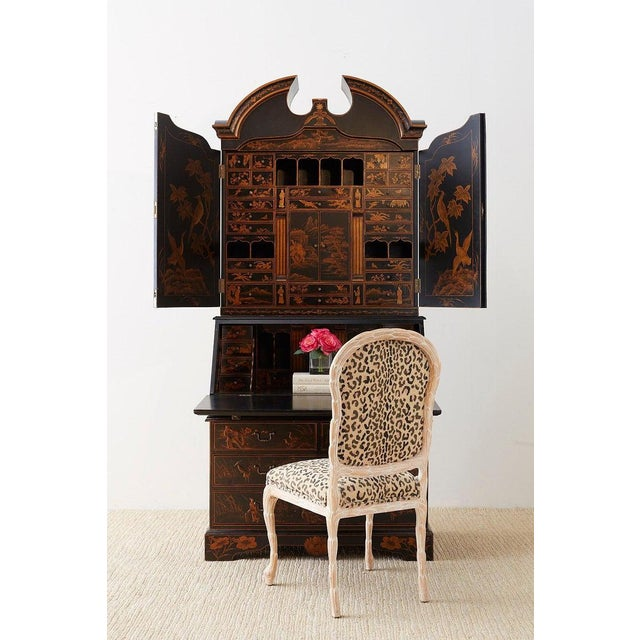 Grand English Georgian style lacquered secretaire featuring a parcel gilt decoration in the chinoiserie taste. The top of...