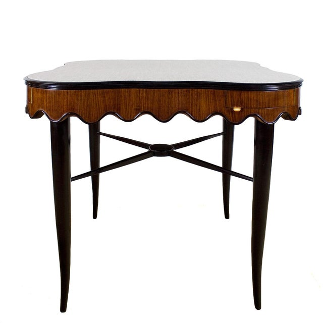 Charming game table, solid stained mahogany stands with crossbar, mahogany undulating ring base, corner drawers with brass...