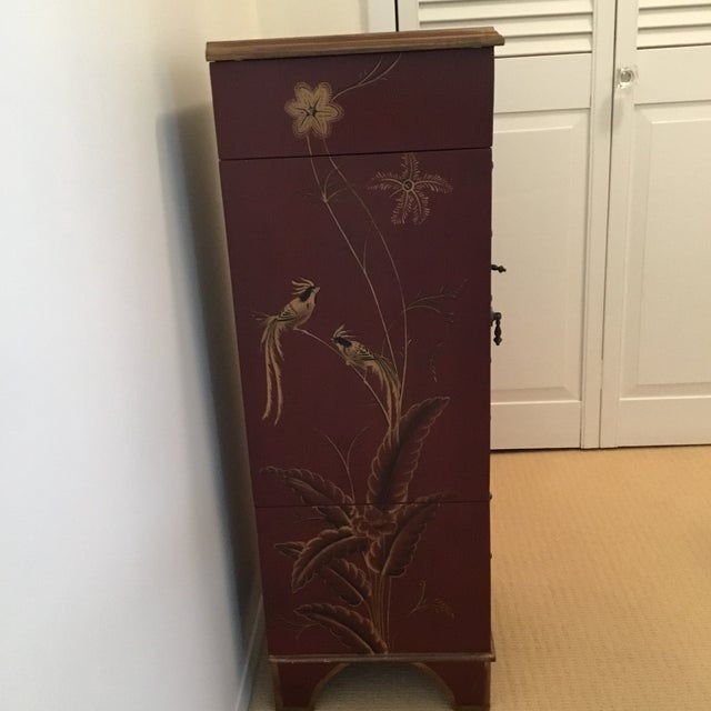 This is a very versatile jewelry chest with the top that has a mirror, velvet drawers, ring sections, side opens to hang...