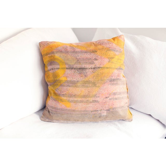 A funky and stylish graffiti print pillow by ABC Carpet and Home. Each side of the pillow has a different pattern, to flip...