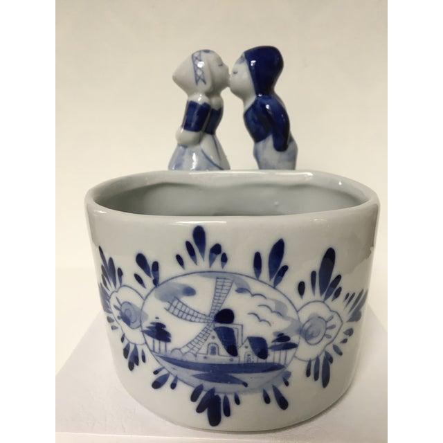 Delftware ceramic oval bowl/container with sweet Dutch boy and girl kissing on top of rim. Beautiful blue and white hand...
