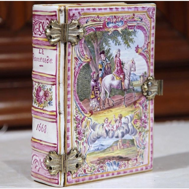 This unique antique porcelain box was sculpted in Paris, circa 1840. The book is called La Promenade and dated 1668 on the...