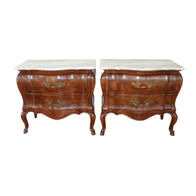 Well constructed walnut bombe chests made by John Widdicomb. Minor, faint stains to calcutta marble tops.
